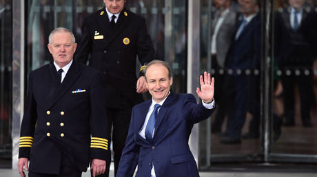 Fianna Fail leader Micheal Martin waves to the gathered media after being elected Taoiseach at the Convention Centre on June 27, 2020 in Dublin, Ireland