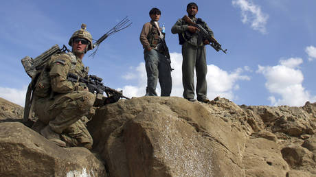 FILE PHOTO: Afghan policemen and a US soldier with the 4th US Cavalry Regiment carry out a patrol in Paktika province, Afghanistan.