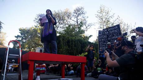 City Councilmember Kshama Sawant speaks to protesters outside Mayor Jenny Durkan's home, Seattle, Washington, June 28, 2020.
