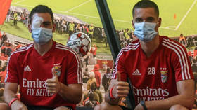 'They're animals!' Benfica condemn 'CRIMINALS' after team bus is STONED in attack