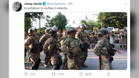 National Guard dance the 'Macarena' before enforcing Atlanta curfew. Twitter users argue it's a way of normalizing militarization