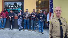 Police chief ousted for backing 'gun-toting' vigilantes who defended small town from alleged 'Antifa threat'