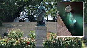 WATCH: Crowd tears down, sets alight, then SPITS ON Columbus statue before throwing it in nearby lake