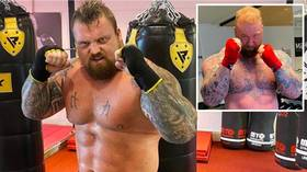 'Putting that GRAFT in': Eddie Hall shows SHREDDED physique as strongman prepares to box 'Game of Thrones' giant Bjornsson