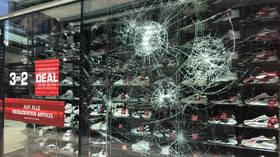 Merkel calls Stuttgart looting & attacks on police 'abhorrent'