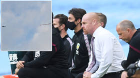 'A DISGRACE': Outrage after 'WHITE LIVES MATTER' banner flies over stadium as Man City & Burnley stars take knee before match