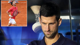 'Our wish is that you die': CHILLING messages to tennis ace Djokovic daubed on street walls after World No.1's coronavius fiasco