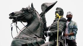 Four charged for vandalizing Jackson statue near White House as Trump demands maximum punishment