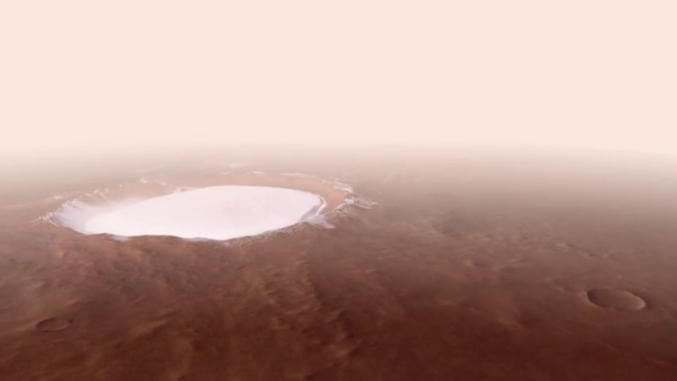 For the crater good: ESA shares incredible, never-before-seen view of icy Martian canyon (VIDEO)