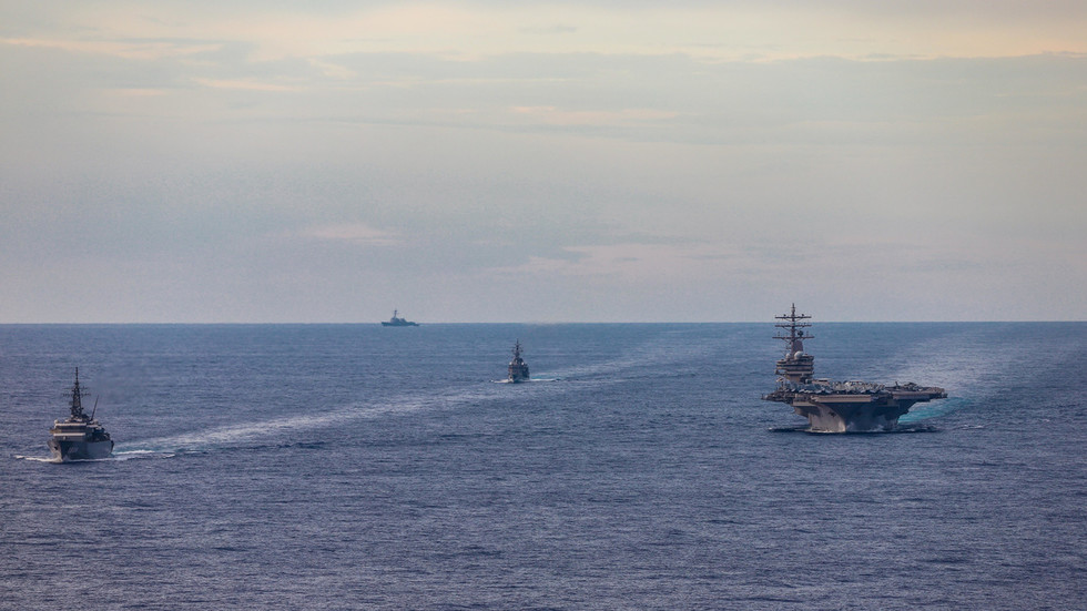 US says Beijing's claims in South China Sea are 'completely unlawful' and condemns China for 'bullying' other countries