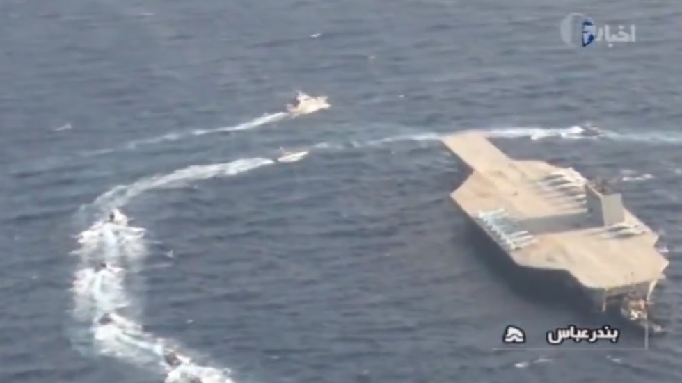 Watch Iran fire missile & overtake mock US aircraft carrier during Strait of Hormuz war games (VIDEO)