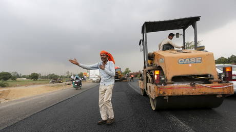 Highway construction in Manesar in the northern state of Haryana, India, July 9, 2015.