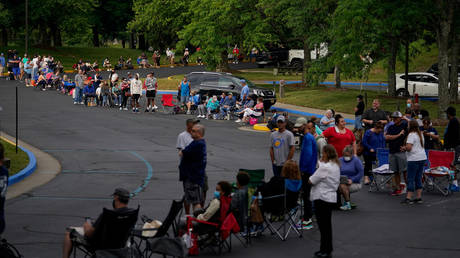 People line up outside Kentucky Career Center prior to its opening to find assistance with their unemployment claims in Frankfort, Kentucky, US, June 18, 2020