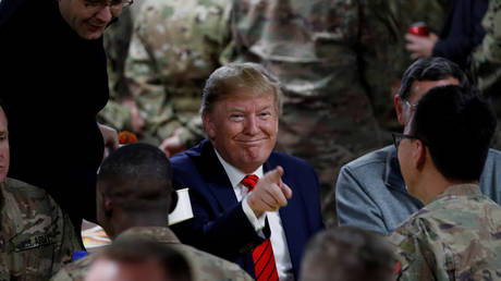 FILE PHOTO: US President Donald Trump eats dinner with US troops at a Thanksgiving dinner event during a surprise visit at Bagram Air Base in Afghanistan, November 28, 2019.