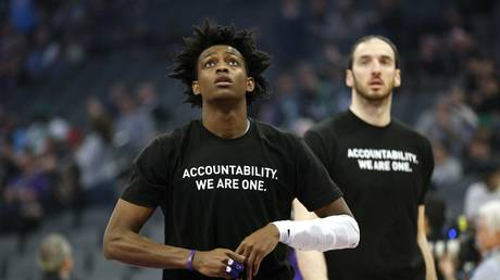 FILE PHOTO: Sacramento Kings guard De'Aaron Fox stands on the court before the start of a game against the Boston Celtics, at which players from both teams wore shirts during warm-ups in honor of a California man killed by police.
