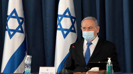 Israeli Prime Minister Netanyahu wears a protective mask as he holds a weekly cabinet meeting on July 5, 2020.