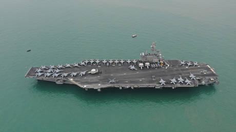 FILE PHOTO: US Navy aircraft carrier USS Ronald Reagan. November 2018. © Reuters / Caixin Media / Liang Yingfei