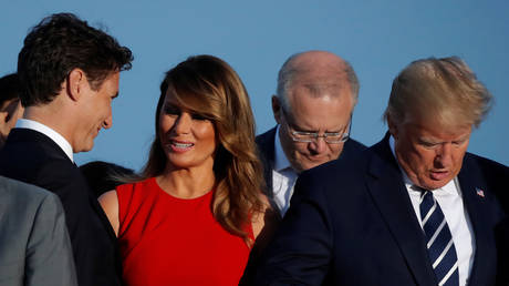 First Lady Melania Trump speaks with Canada's PM Justin Trudeau next to the US President Donald Trump at the G7 summit in Biarritz, France, August 25, 2019. © Reuters / Carlos Barria