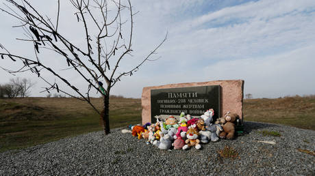 Toys are placed at a memorial to victims of Malaysia Airlines Flight MH17 plane crash near the village of Hrabove in Donetsk region, Ukraine March 9, 2020