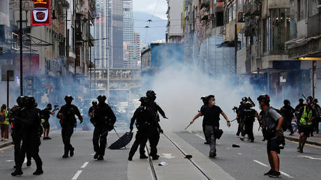 Riot police fire tear gas into the crowds to disperse anti-national security law protesters in Hong Kong, China on July 1, 2020.