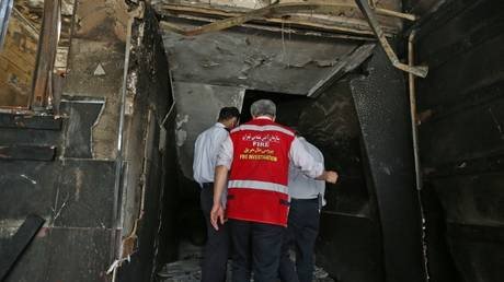 FILE PHOTO Iranian emergency staff inspect the site of an explosion at the Sina At'har health centre in the upmarket northern neighbourhood of Tajrish in the capital Tehran on July 1, 2020. ©  AFP / ATTA KENARE
