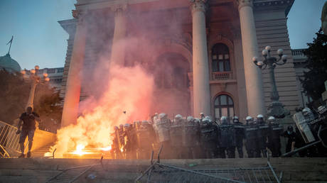 SECOND night of clashes in Serbia as government & opposition blame each other for protests over Covid-19 lockdown - rt