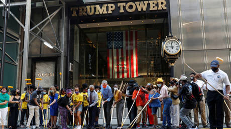 """New York City Mayor Bill de Blasio, his wife Chirlane McCray and Reverend Al Sharpton paint """"Black Lives Matter"""" outside Trump Tower in Manhattan, July 9, 2020."""