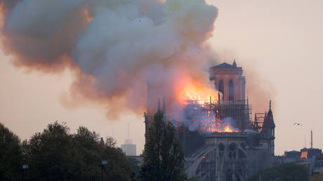 FILE PHOTO: Smoke billows from the burning Notre Dame Cathedral in Paris on April 15, 2019. © Reuters / Charles Platiau