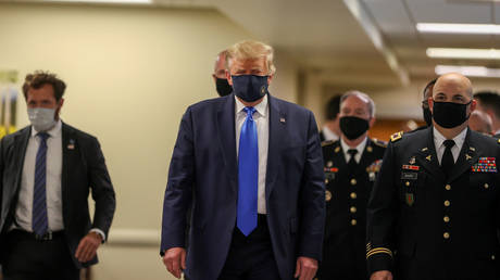 US President Donald Trump wears a mask while visiting Walter Reed National Military Medical Center in Bethesda, Maryland, US, July 11, 2020
