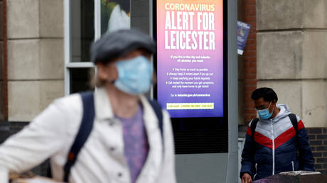 FILE PHOTO: An NHS alert message is seen on a street, following a Covid-19 local lockdown imposed in Leicester © REUTERS/Phil Noble/File Photo