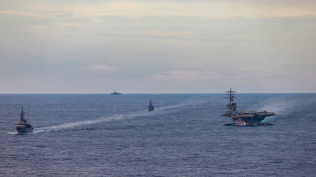 Japanese vessels escort aircraft carrier USS Ronald Reagan in the South China Sea, July 7, 2020.