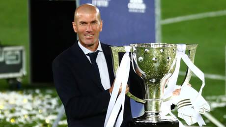 Real Madrid boss Zinedine Zidane with the La Liga title. © Reuters