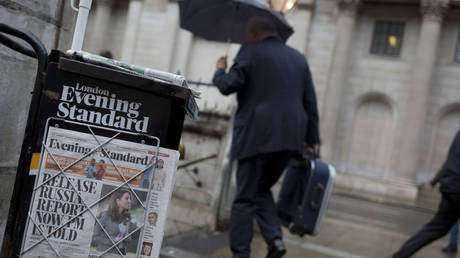 FILE PHOTO: Copies of the London Evening Standard newspaper lead with a headline about government ministers' controversial decision to hold back until after the current general election on 12th November 2019, in the City of London, England
