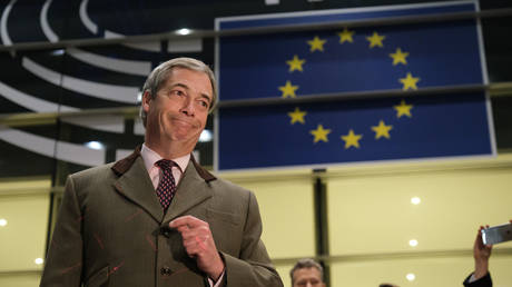 "FILE PHOTO: Nigel Farage speaks to the media as he departs following a historic vote for the Brexit agreement at a session of the European Parliament that paves the way for an ""orderly"" departure of the United Kingdom from the EU on January 29, 2020 in Brussels, Belgium"