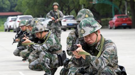 The militia trained in tactics. Taicang, Jiangsu Province, China, July 23, 2020