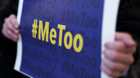 FILE PHOTO: An activist holds a #MeToo sign during a news conference on a Title IX lawsuit outside the Department of Education January 25, 2018 in Washington