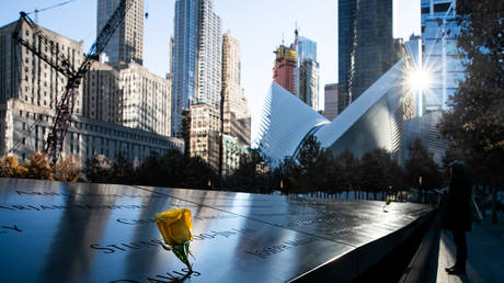 FILE PHOTO: Yellow roses are placed on the 9/11 Memorial in New York City.