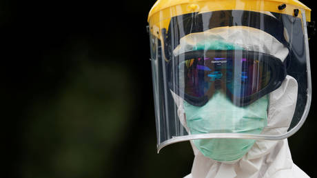 A health worker wears sports goggles during COVID-19 outbreak on the outskirts of Jakarta, Indonesia