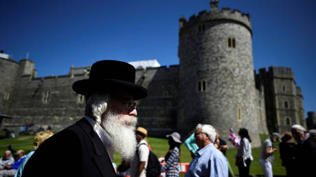 FILE PHOTO: An Orthodox Jew walks past Windsor Castle during rehearsals for the wedding of Britain's Prince Harry and Meghan Markle in Windsor, Britain, May 17, 2019.