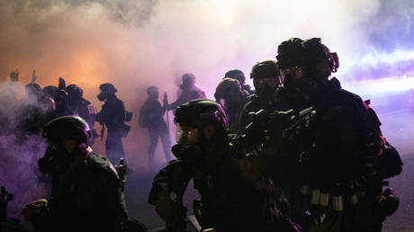 Federal law enforcement officers fire tear gas and other munitions during demonstration in Portland, Oregon