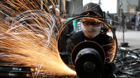 FILE PHOTO: A factory manufacturing sports equipment in Hangzhou, Zhejiang province, China © Reuters