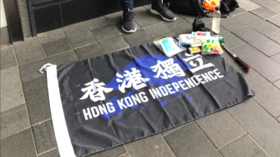 Hong Kong police arrest 1st person under new security law banning independence flags