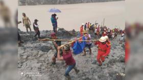 At least 100 killed by monsoon-triggered mudslide at jade mine in Myanmar
