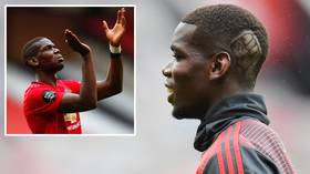 A cut above: Manchester United ace Paul Pogba shaves 'Black Lives Matter' emblem into his hair in support of anti-racism campaign