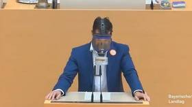 AfD lawmaker shows up wearing GAS MASK in sarcastic nod to German anti-Covid measure