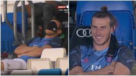 'He's paid €15 million a year for this': Playful Gareth Bale uses mask to SNOOZE on bench as Real Madrid play Alaves (VIDEO)