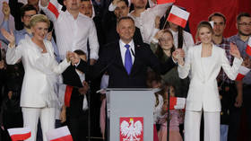 Poland's President Andrzej Duda slightly ahead of his rival in tight runoff – exit polls