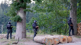 'Black Forest Rambo': German police in manhunt for suspect who disarmed four officers & fled into the wild armed 'with a bow'