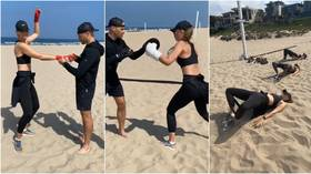 'Hello outdoor workout!' Maria Sharapova boxes on the beach as retired star proves she's in fighting shape (VIDEO)