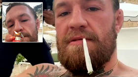 Living the high life: Fans watch ex-UFC champ McGregor toke HUGE roll-up on lounger as star enjoys retirement (VIDEO)